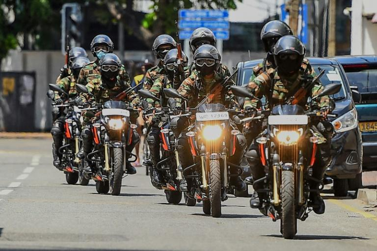 Security personnel patrol a street in Colombo on April 23, 2020 during a government-imposed nationwide coronavirus lockdown in Sri Lanka (AFP Photo/Ishara S. KODIKARA)