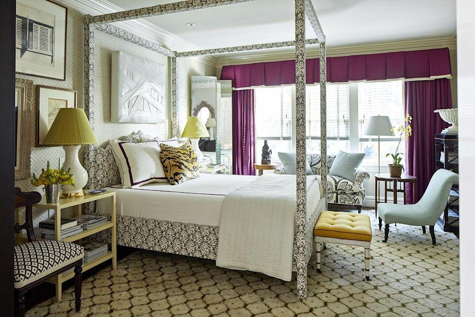 <p>When designing your main bedroom, the only real rule is to be true to your personal style. If that means mixing fun prints and using bold colors, don't hesitate to do so. Take inspiration from Matthew Carter's bold purple window treatments. </p>
