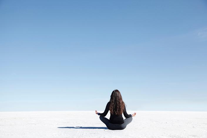 "<h1 class=""title"">Woman meditation pose facing camera on salt flat</h1> <cite class=""credit"">Photo: Michael Duva / Via Getty Images</cite>"