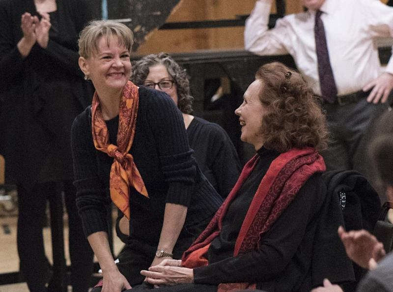 This Oct. 24, 2016 image released by the Metropolitan Opera shows Susanna Malkki, left, and Kaija Saariaho on the first day of rehearsal for the Met's new production of Saariaho's L'Amour de Loin in New York. It is the second work by a woman composer in the company's history and the first since 1903. (Jonathan Tichler/Metropolitan Opera via AP)