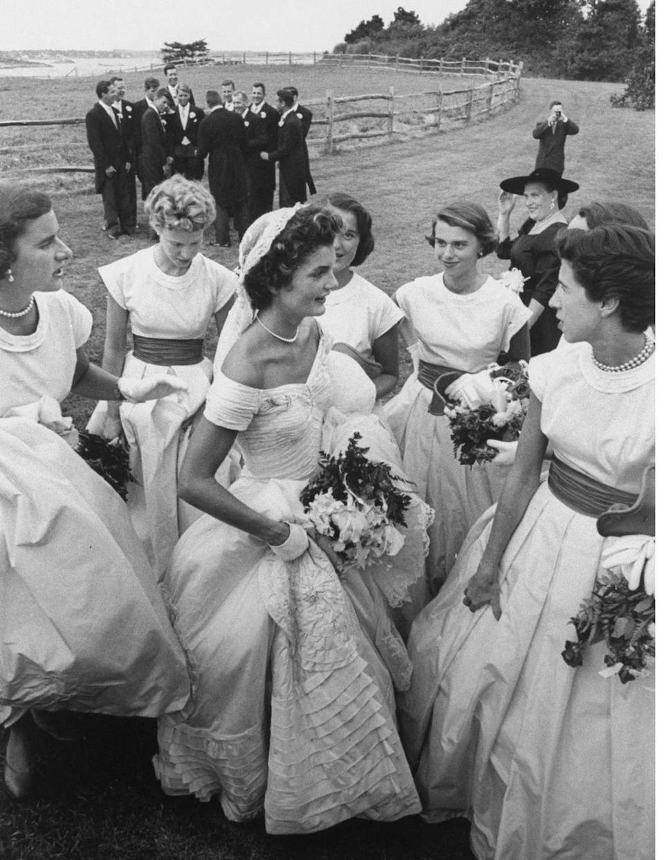 <p>Jackie's bridal party included her sister, Lee, stepsister Nina Auchincloss, John's sister Jean, and his sister-in-law Ethel. There were 10 bridesmaids in total, and they wore pink taffeta.</p>