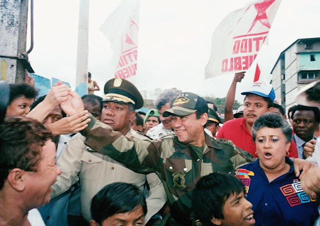 <p>Panama's Gen. Manuel Antonio Noriega greeting people in the Chorillo neighborhood on May 3, 1989, at a housing project dedication in Panama City. (AP Photo/John Hopper) </p>
