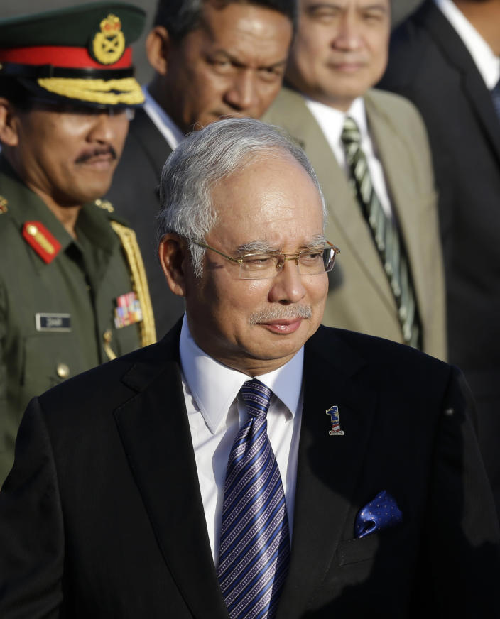 Malaysian Prime Minister Najib Razak arrives at Villamor Air Base at suburban Pasay city, south of Manila, Sunday Oct. 14, 2012. Najib is here for a three-day official visit, highlight of which is to witness the formal signing of a tentative peace agreement between the government and the Moro Islamic Liberation Front (MILF) of which Malaysia helped broker. (AP Photo/Bullit Marquez)