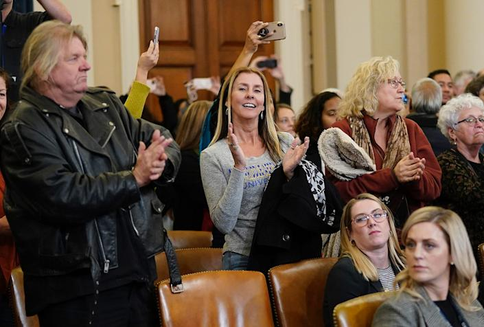 Members of the public in the audience applaud as former U.S. Ambassador to Ukraine Marie Yovanovitch concludes her testimony before the House Intelligence Committee in the Longworth House Office Building on Capitol Hill November 15, 2019