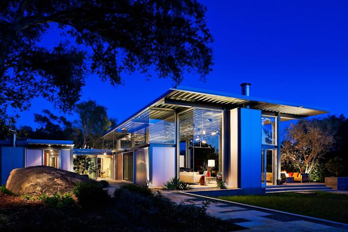 This home in Montecito designed by architect Barton Myers and designer Mark Rios of Rios Clementi Hale Studios combines modern and industrial style. The steel-and-glass house highlights the surrounding environment with retractable glass walls that open onto the landscaping, which includes drought-tolerant garden rooms and a Japanese-style courtyard. A guesthouse designed by architect Andy Neumann is located at one end of the property and a 50-meter lap pool sits at the other.
