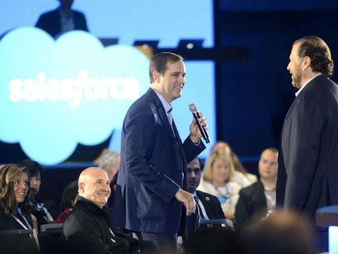 <p>Chuck Robbins CEO of Cisco Sytems (L) and Marc Benioff speak at the Salesforce keynote during Dreamforce 2015</p> (Getty Images)