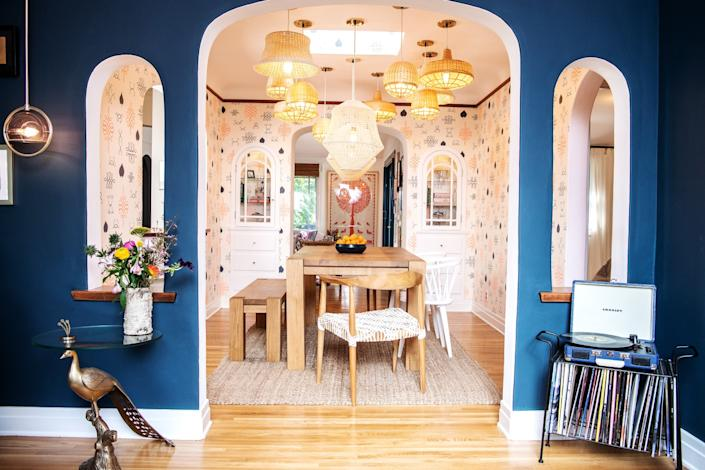 """Arden Myrin installed multiple Ikea chandeliers in the dining room. <span class=""""copyright"""">(Mariah Tauger / Los Angeles Times)</span>"""