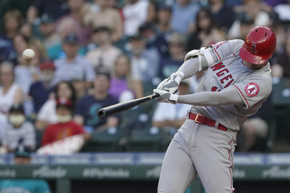 Los Angeles Angels' Shohei Ohtani hits a solo home run during the third inning of a baseball game against the Seattle Mariners, Friday, July 9, 2021, in Seattle. (AP Photo/Ted S. Warren)