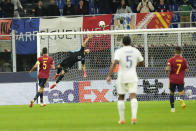 France's Karim Benzema, not seen in the picture, scores during the UEFA Nations League final soccer match between France and Spain at the San Siro stadium, in Milan, Italy, Sunday, Oct. 10, 2021. (AP Photo/Luca Bruno)