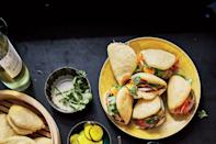 """These pillowy steamed buns are the perfect receptacle for shredded turkey and a gently spiced sauce. <a href=""""https://www.epicurious.com/recipes/food/views/cornmeal-bao-with-turkey-and-black-pepper-sauce?mbid=synd_yahoo_rss"""" rel=""""nofollow noopener"""" target=""""_blank"""" data-ylk=""""slk:See recipe."""" class=""""link rapid-noclick-resp"""">See recipe.</a>"""