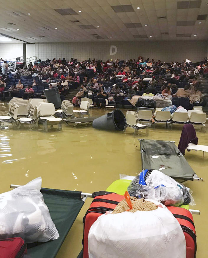 <em>Evacuees sit in the bleachers at the Bowers Civic Center in Port Arthur, Texas (AP)</em>