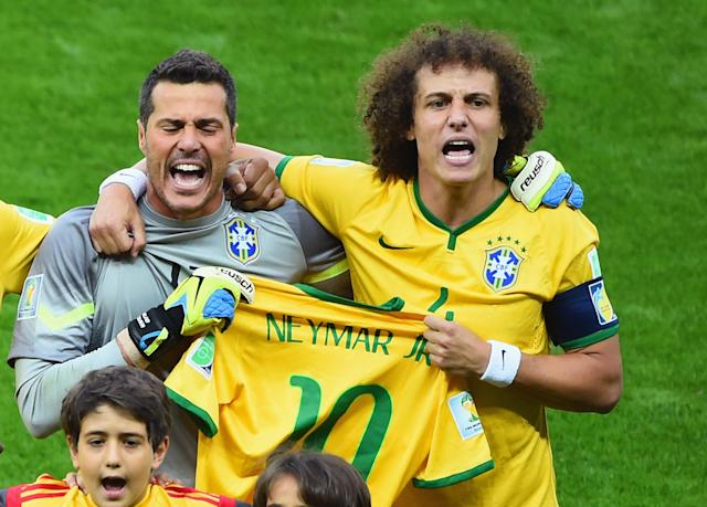 <p>David Luiz and Julio Cesar hold up Neymar's shirt for the national anthem ahead of their Germany clash </p>