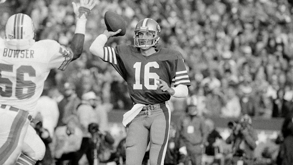 Mandatory Credit: Photo by Anonymous/AP/Shutterstock (6577908f)Joe Montana San Francisco 49ers quarterback Joe Montana (16) unloads to downfield receiver over rushing hands of Miami Dolphins linebacker Charles Bowser (56) during first quarter of Super Bowl XIX at Stanford Stadium, Calif.