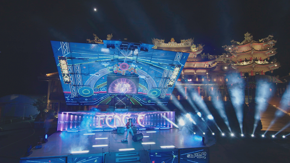 In this exclusive photo, ukulele player Feng E performs on an elaborate stage in Taipei, Taiwan, as part of the 'America's Got Talent' quarterfinals competition that will air on Tuesday.
