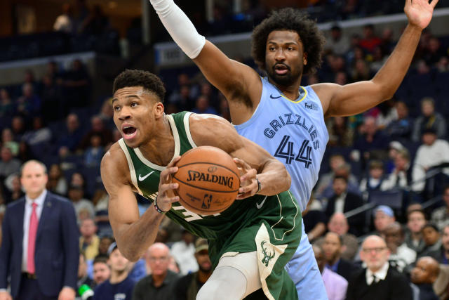Milwaukee Bucks forward Giannis Antetokounmpo drives ahead of Memphis Grizzlies forward Solomon Hill (44) in the first half of an NBA basketball game Friday, Dec. 13, 2019, in Memphis, Tenn. (AP Photo/Brandon Dill)