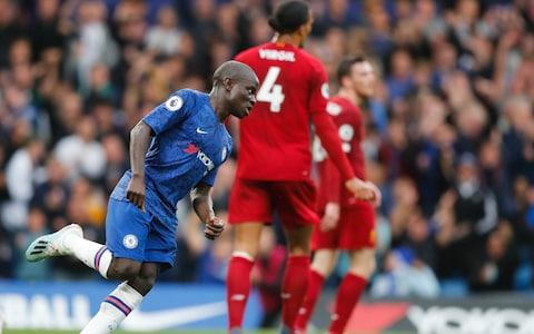 Chelsea's N'Golo Kante celebrates after scoring his side's opening goal during the British Premier League soccer match between Chelsea and Liverpool, at the Stamford Bridge Stadium, London, Sunday, Sept. 22, 2019 - Credit: AP