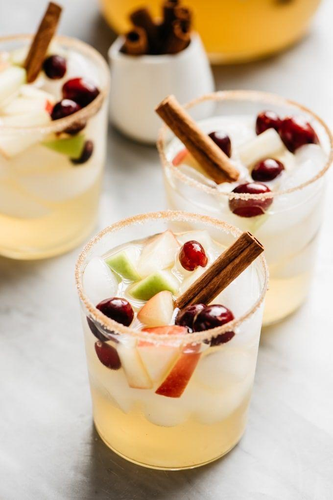 """<p>This drink includes tart apples, sweet apples, cranberries, cider, and a combination of spirits (plus white wine!) for a fantastic autumnal version of the classic.<br></p><p><a class=""""link rapid-noclick-resp"""" href=""""https://oursaltykitchen.com/apple-cider-sangria/"""" rel=""""nofollow noopener"""" target=""""_blank"""" data-ylk=""""slk:GET THE RECIPE"""">GET THE RECIPE</a></p>"""