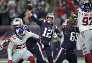 New England Patriots quarterback Tom Brady passes under pressure from the New York Giants in the first half of an NFL football game, Thursday, Oct. 10, 2019, in Foxborough, Mass. (AP Photo/Charles Krupa)