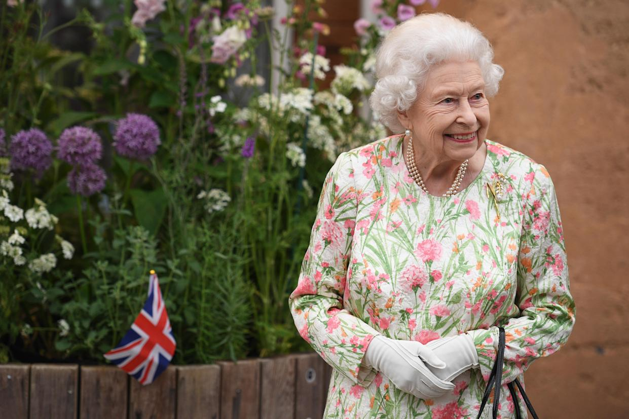 ST AUSTELL, ENGLAND - JUNE 11: Queen Elizabeth II smiles as she meets people from communities across Cornwall during an event in celebration of The Big Lunch initiative at The Eden Project during the G7 Summit on June 11, 2021 in St Austell, Cornwall, England. UK Prime Minister, Boris Johnson, hosts leaders from the USA, Japan, Germany, France, Italy and Canada at the G7 Summit. This year the UK has invited India, South Africa, and South Korea to attend the Leaders' Summit as guest countries as well as the EU. (Photo by Oli Scarff - WPA Pool / Getty Images)