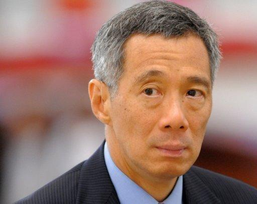Prime Minister Lee Hsien Loong's sweeping changes to government signals that he is serious about change, say analysts. (AFP photo)