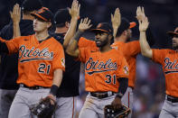 Baltimore Orioles left fielder Austin Hays (21) and center fielder Cedric Mullins (31) celebrate with teammates after a baseball game against the Detroit Tigers, Saturday, July 31, 2021, in Detroit. (AP Photo/Carlos Osorio)