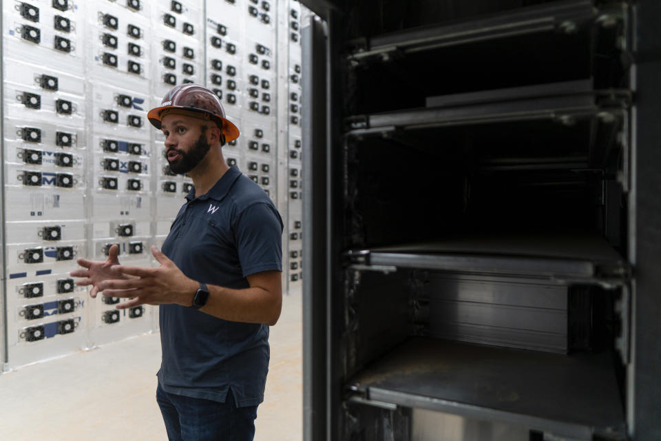 ROCKDALE, TX - JUNE 23: David Schatz, Vice President of Operations for Whinstone, a cryptocurrency mining company recently acquired by Riot Blockchain, explains how miners work at a Riot Blockchain facility in Rockdale, TX, on June 23, 2021. Riot Blockchain, a Bitcoin mining company that hosts Bitcoin mining equipment for clients, houses the largest Bitcoin mining facility in the U.S. in Rockdale, TX.