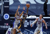 New Orleans Pelicans guard Eric Bledsoe shoots against Detroit Pistons guard Frank Jackson, top left, during the first half of an NBA basketball game in New Orleans, Wednesday, Feb. 24, 2021. (AP Photo/Gerald Herbert)