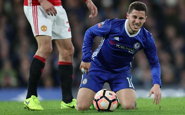 <span>Hazard grimaces in an FA Cup tie between the sides last month</span> <span>Credit: Rex Features </span>