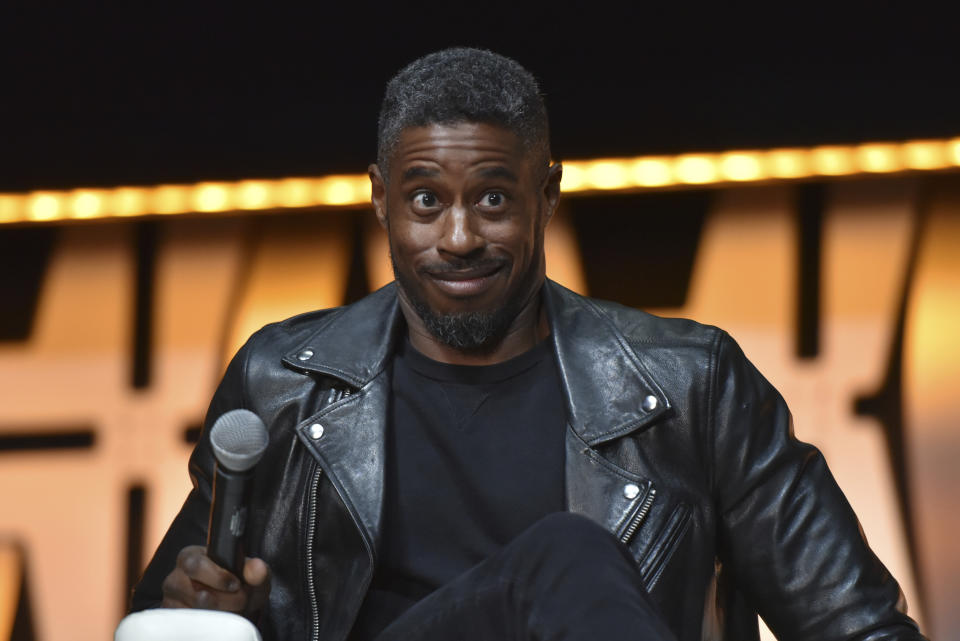 """Ahmed Best participates during the """"Star Wars: Phantom Menace 20th Anniversary Celebration"""" panel on day 4 of the Star Wars Celebration at Wintrust Arena on Monday, April 15, 2019, in Chicago. (Photo by Rob Grabowski/Invision/AP)"""