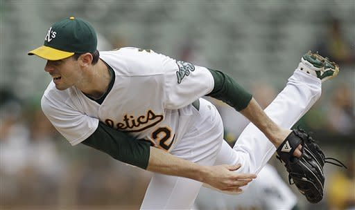 Oakland Athletics' Brandon McCarthy follows through on a pitch to a Los Angeles Angels batter in the first inning of a baseball game Wednesday, Sept. 5, 2012, in Oakland, Calif. (AP Photo/Ben Margot)