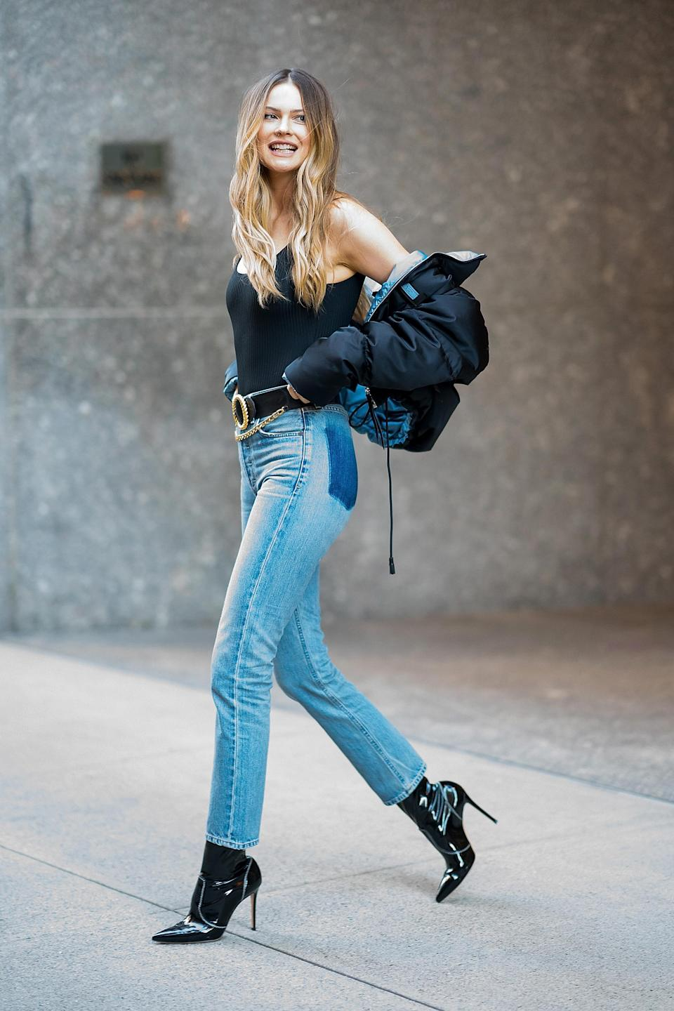 """<p>Behati Prinsloo attended the Victoria's Secret fittings in a seriously covetable pair of <a href=""""https://www.citizensofhumanity.com/womens/all-womens/straight/charlotte-high-rise-straight-in-barrow"""" rel=""""nofollow noopener"""" target=""""_blank"""" data-ylk=""""slk:jeans"""" class=""""link rapid-noclick-resp"""">jeans</a> by Citizens of Humanity. The model finished the look with a body and draped puffer jacket. <em>[Photo: Getty]</em> </p>"""
