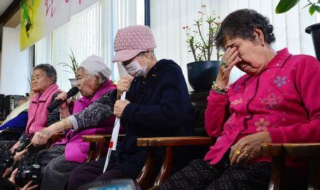 "Former South Korean ""comfort woman"" Lee Ok-sun speaks as the others react during a news conference at the ""House of Sharing,"" a special shelter for former ""comfort women"", in Gwangju, South Korea, December 28, 2015. REUTERS/News1"