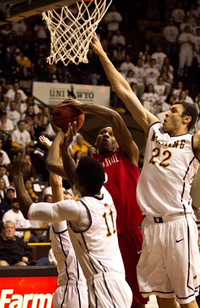 San Diego State forward Skylar Spencer (0) goes up against the University of Wyoming Cowboys defense Tuesday, Feb. 11, 2014 at the Arena-Auditorium in Laramie, Wyo. (AP Photo/Jeremy Martin)
