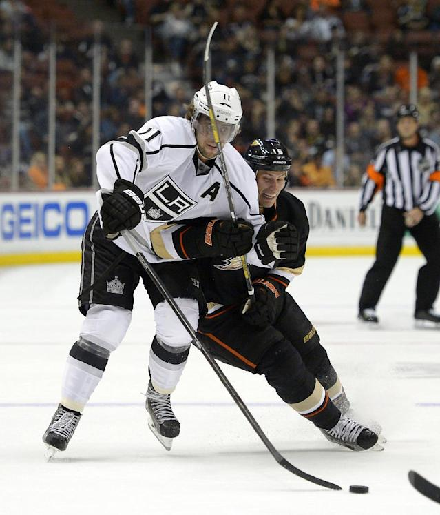 Los Angeles Kings center Anze Kopitar, left, and Anaheim Ducks center Ryan Getzlaf vie for the puck during the second period of a preseason NHL hockey game, Tuesday, Sept. 17, 2013, in Anaheim, Calif. (AP Photo/Mark J. Terrill)