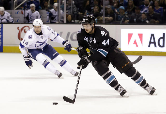 San Jose Sharks' Marc-Edouard Vlasic (44) controls the puck behind Tampa Bay Lightning's Brett Connolly (14) during the second period of an NHL hockey game Sunday, Feb. 15, 2015, in San Jose, Calif. (AP Photo/Marcio Jose Sanchez)