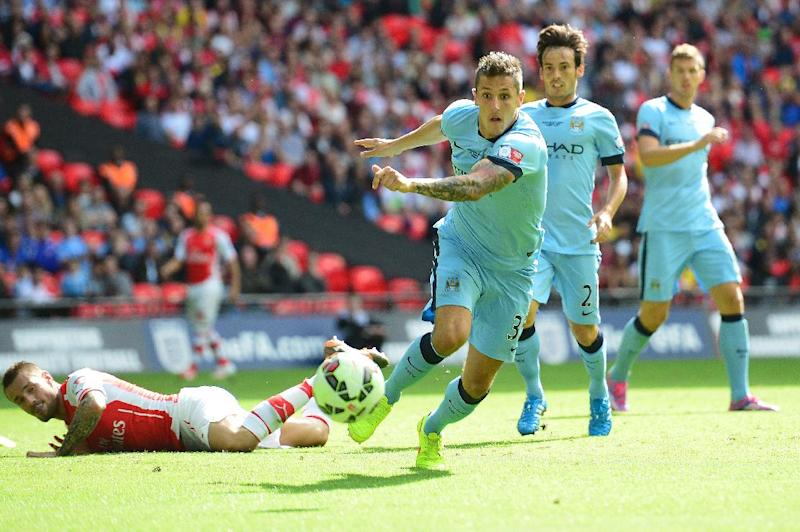 Manchester City striker Stevan Jovetic (C) during the FA Community Shield match against Arsenal at Wembley Stadium on August 10, 2014