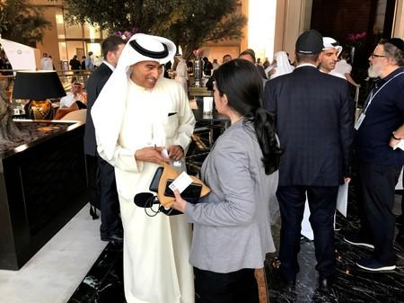 "FILE PHOTO: Emirati businessman Mohamed Alabbar, chairman of Dubai-based Emaar Properties, talks to an Israeli radio journalist at the ""Peace to Prosperity"" conference, in Manama"