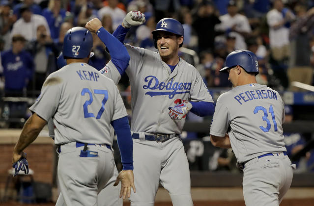Los Angeles Dodgers' Cody Bellinger, center, celebrates with teammates after hitting a grand slam against the New York Mets during the sixth inning of a baseball game, Friday, June 22, 2018, in New York. (AP Photo/Julie Jacobson)