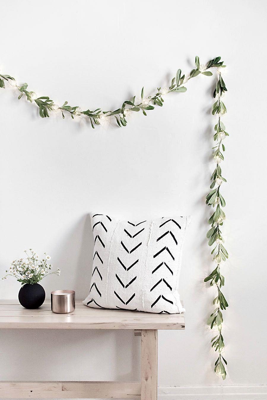 """<p>Make your average strand of cafe lights stand out even when the lights aren't on—all you need is a little live greenery. </p><p><a href=""""https://www.homeyohmy.com/diy-string-lights-garland/"""" rel=""""nofollow noopener"""" target=""""_blank"""" data-ylk=""""slk:Get the tutorial."""" class=""""link rapid-noclick-resp"""">Get the tutorial.</a></p><p><a class=""""link rapid-noclick-resp"""" href=""""https://www.amazon.com/AmazonBasics-Patio-Lights-White-50/dp/B073WFL878?tag=syn-yahoo-20&ascsubtag=%5Bartid%7C10072.g.37499128%5Bsrc%7Cyahoo-us"""" rel=""""nofollow noopener"""" target=""""_blank"""" data-ylk=""""slk:SHOP STRING LIGHTS"""">SHOP STRING LIGHTS</a></p>"""