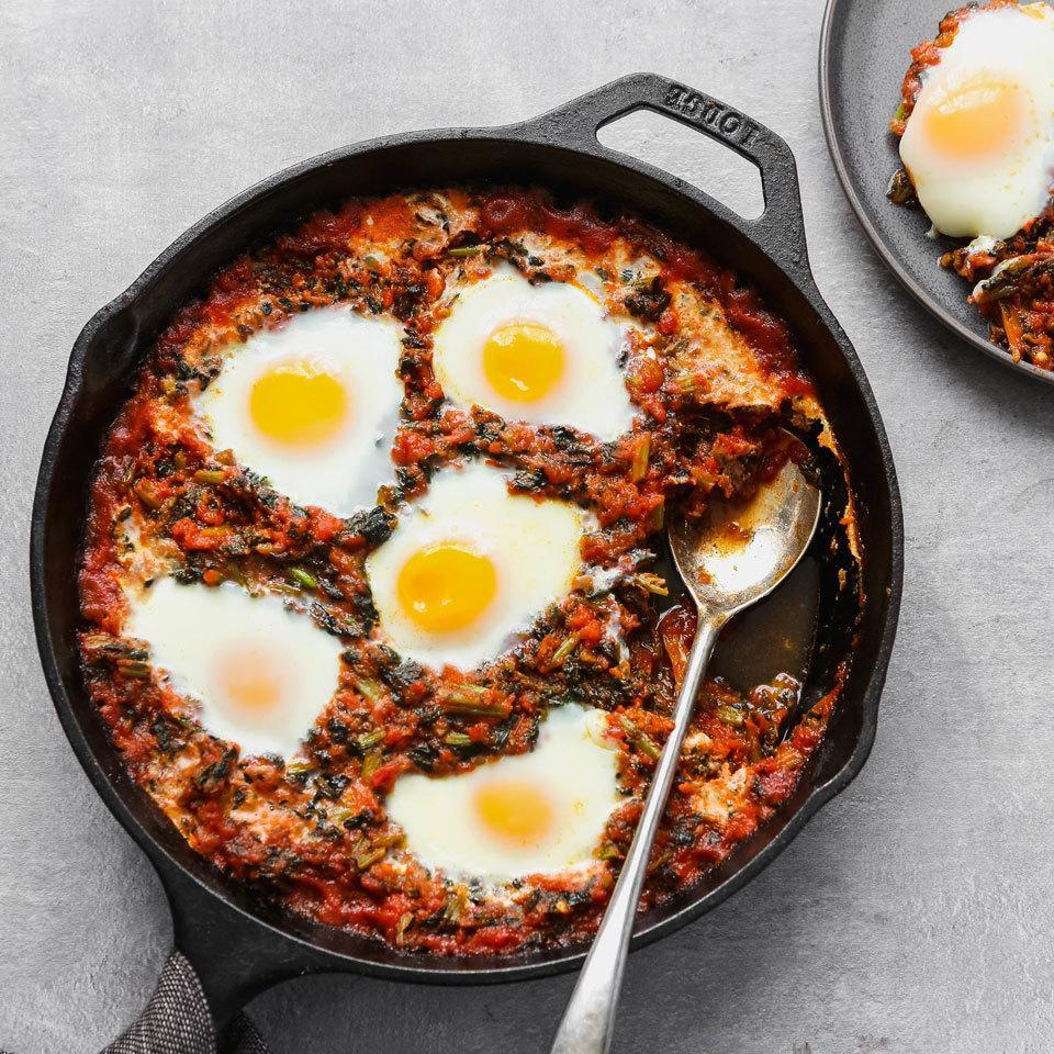 <p>You can make these three-ingredient tomato-simmered eggs with things you probably already have on hand in your freezer and pantry. To make these baked eggs more like eggs in purgatory, look for a spicy tomato sauce and don't forget some whole-wheat bread for dipping.</p>