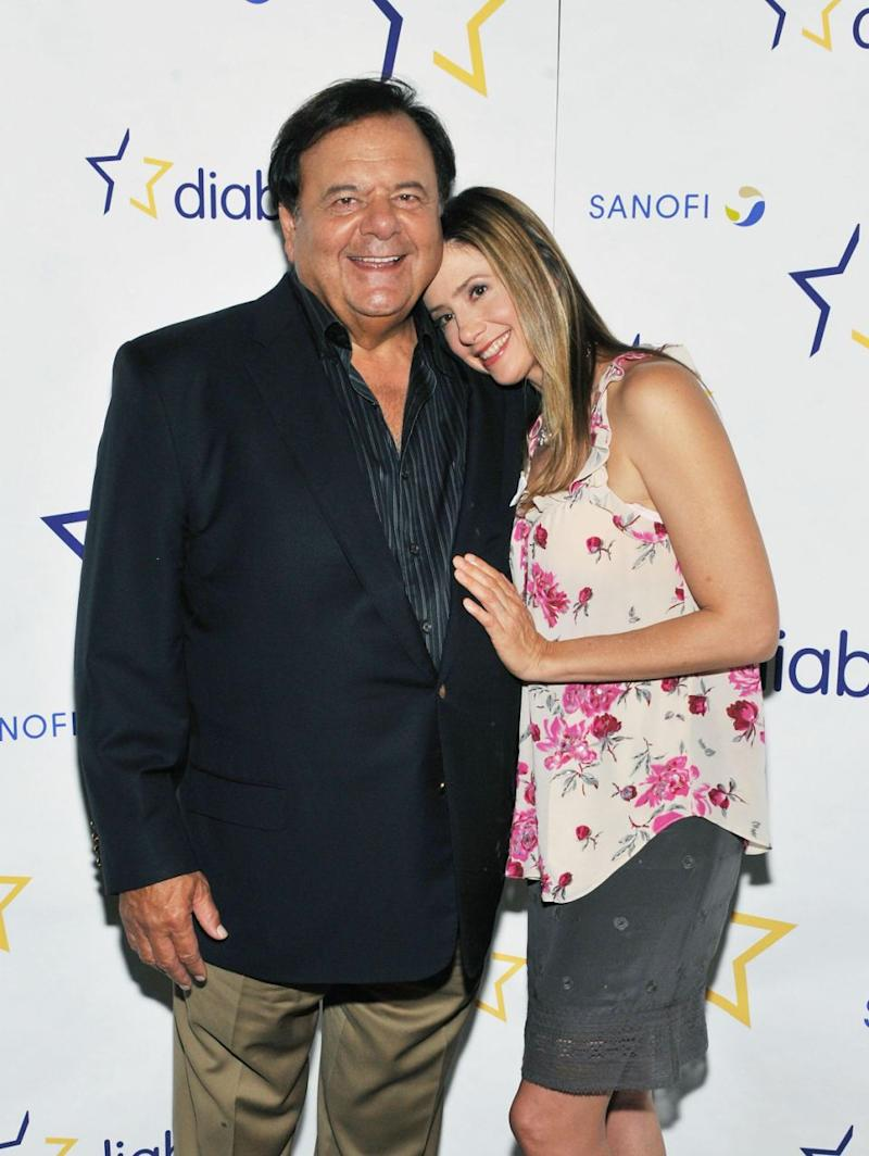 Mira is standing by her dad. The pair seen here together in 2013. Source: Getty