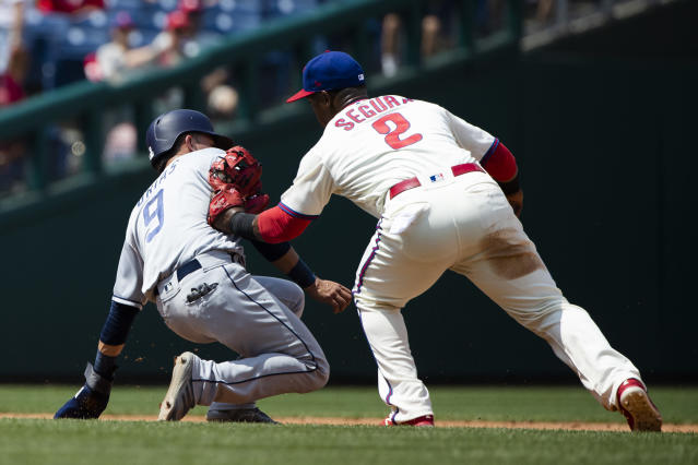 Philadelphia Phillies' Jean Segura (2) tags out San Diego Padres' Luis Urias during the second inning of a baseball game, Sunday, Aug. 18, 2019, in Philadelphia. (AP Photo/Matt Rourke)