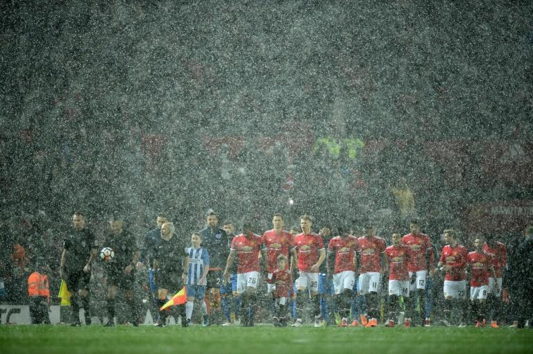 Snow joke: Man United overcame the extreme weather at Old Trafford to beat Brighton 2-0 in the FA Cup quarter-finals