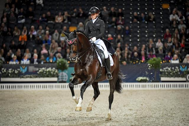 Equestrian - Sweden International Horse Show - Fei Grand Prix Dressage Qualification Event - Friends Arena, Stockholm, Sweden - December 2, 2017. Anna Zibrandtsen of Denmark rides her horse Arlando. TT News Agency/Jessica Gow via REUTERS ATTENTION EDITORS - THIS IMAGE WAS PROVIDED BY A THIRD PARTY. SWEDEN OUT. NO COMMERCIAL OR EDITORIAL SALES IN SWEDEN
