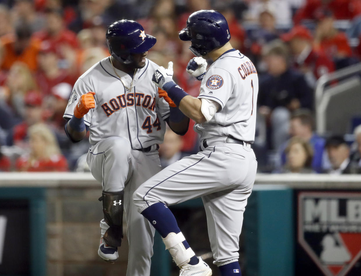 WASHINGTON, DC - OCTOBER 27:  Yordan Alvarez #44 of the Houston Astros celebrates with Carlos Correa #1 after hitting a two-run home run in the second inning of Game 5 of the 2019 World Series between the Houston Astros and the Washington Nationals at Nationals Park on Sunday, October 27, 2019 in Washington, District of Columbia. (Photo by Rob Tringali/MLB Photos via Getty Images)