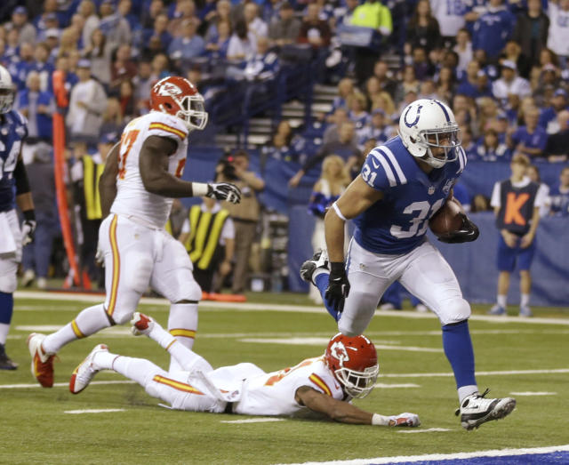Indianapolis Colts' Donald Brown (31) makes a 10-yard touchdown run against the Kansas City Chiefs during the second half of an NFL wild-card playoff football game Saturday, Jan. 4, 2014, in Indianapolis. (AP Photo/Michael Conroy)