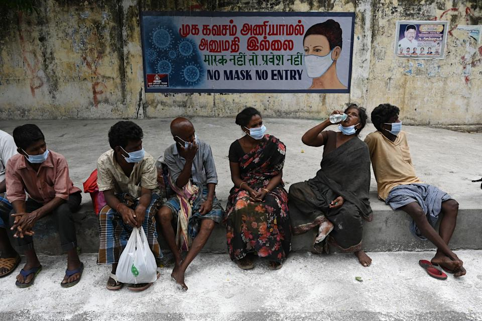 People wait to receive a meal lockdown Chennai