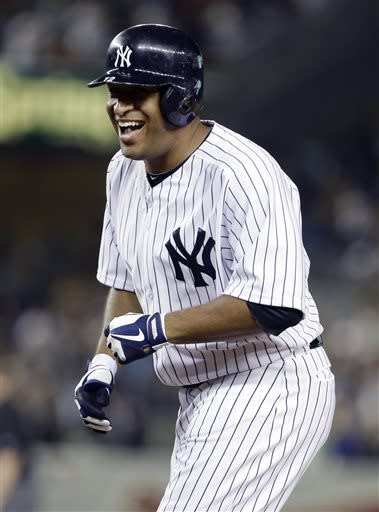 New York Yankees' Vernon Wells reacts after hitting an RBI-single to end a baseball game against the Baltimore Orioles, Friday, July 5, 2013, in New York. The Yankees won the game 3-2. (AP Photo/Frank Franklin II)