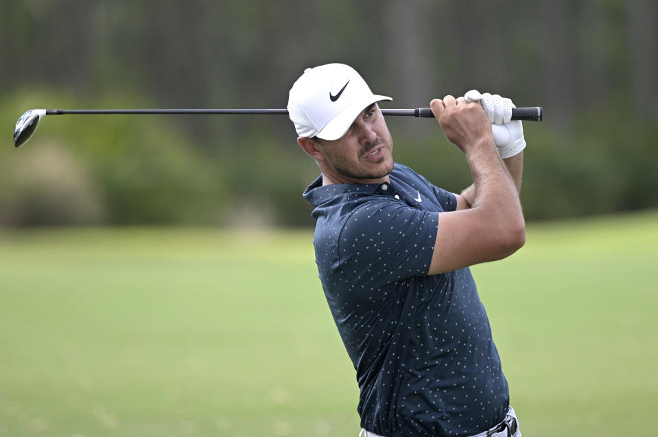 Brooks Koepka hits from the seventh fairway during the final round of the Workday Championship golf tournament Sunday, Feb. 28, 2021, in Bradenton, Fla. (AP Photo/Phelan M. Ebenhack)