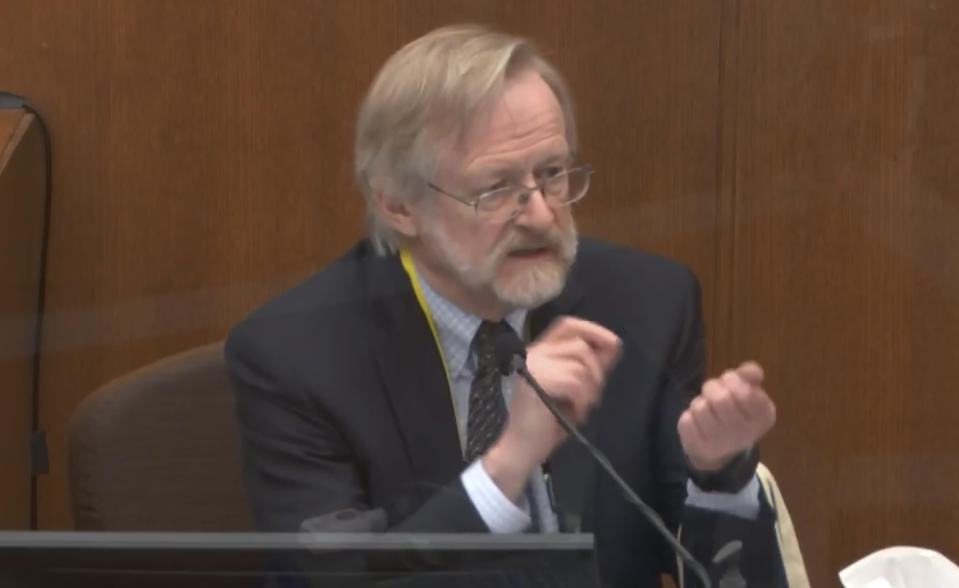 In this image from video, Dr. Martin Tobin testifies as Hennepin County Judge Peter Cahill presides before the court Thursday, April 15, 2021, in the trial of former Minneapolis police Officer Derek Chauvin at the Hennepin County Courthouse in Minneapolis, Minn. Chauvin is charged in the May 25, 2020 death of George Floyd. (Court TV via AP, Pool)